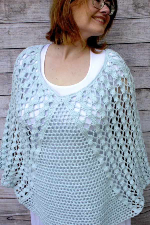 Whimsical Waves Poncho Crochet Pattern featuring Lion Brand's Feels Like Butta Yarn a free pattern!