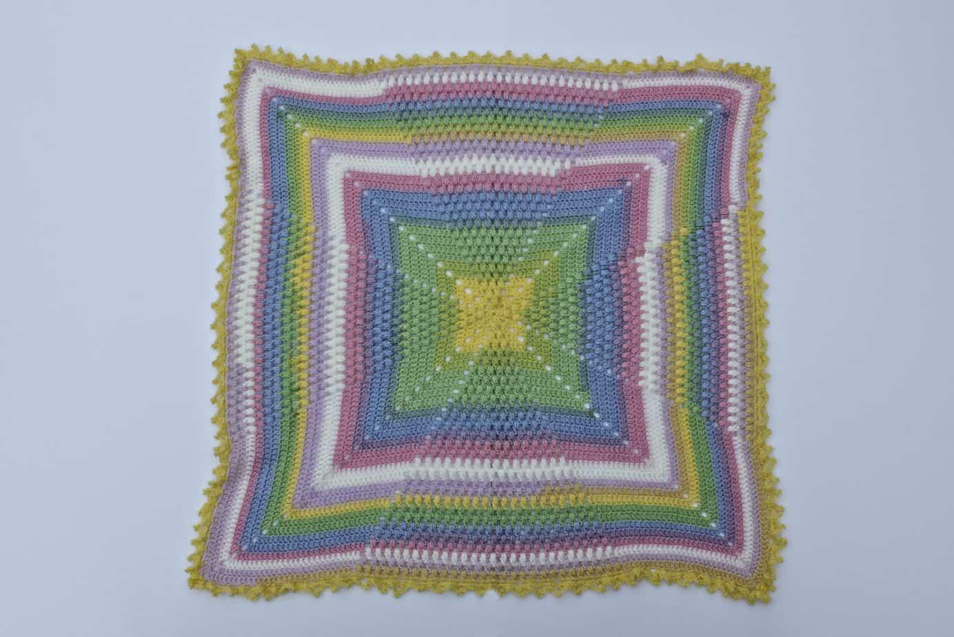 Pineapple of My Eye Baby Blanket in Lion Brand Mandala Baby colorway Neverland. A free crochet pattern!