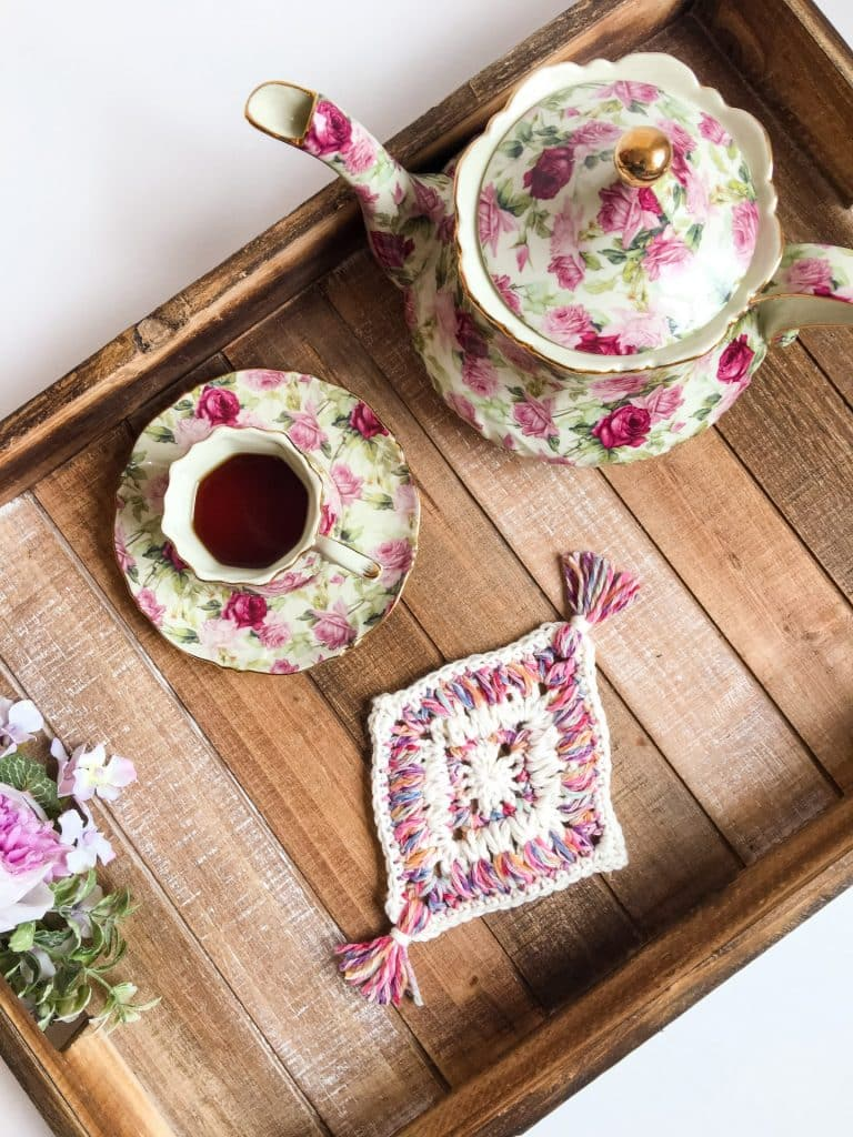Flower Garden Diamond Coaster free crochet pattern on a tea tray